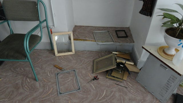 Iranian government agents confiscated photographs, Baha'i books, CDs, and computers during a raid on 14 homes in Abadeh, Iran, on 13 October 2013. Shown here are broken picture frames in a Baha'i home after the raid.