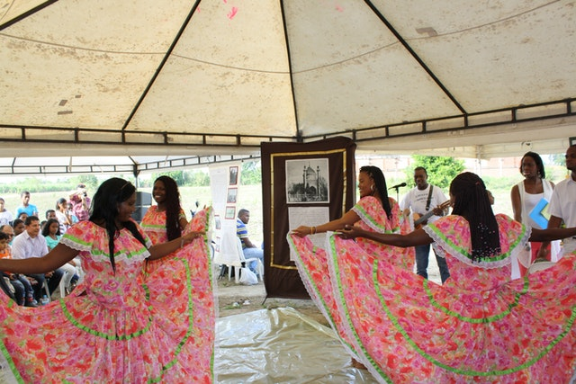 Youth perform a traditional dance from the region.