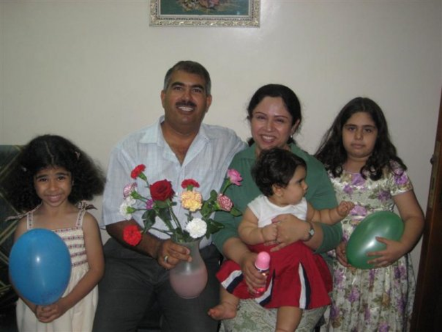 Hamed Kamal bin Haydara with his family, before his imprisonment.