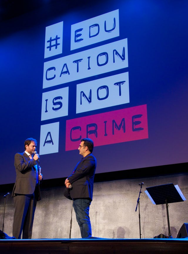 Actor Rainn Wilson converses with journalist and filmmaker Maziar Bahari at the Education is Not a Crime – Live 2015 event in Los Angeles on 27 February 2015.