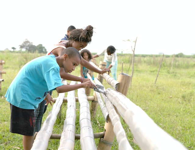 In Agua Azul, youth contribute to the construction of benches surrounding an area where plants are being cultivated for the land surrounding the site for the Baha'i House of Worship.