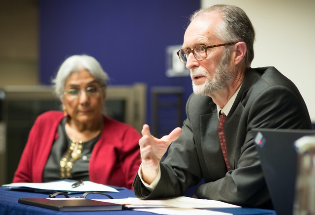 "Gerald Filson, Director of Public Affairs of the Baha'i community of Canada and Chair of the Canadian Interfaith Conversation, and Alia Hogben, director of the Canadian Council of Muslim Women, in a panel discussion at the ""Our Whole Society: Bridging the Religious-Secular Divide"" conference, held 22-24 March 2015 at the University of British Columbia in Vancouver, Canada."