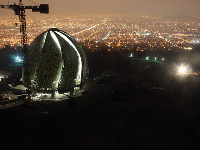 In the foothills of the Andes, the Baha'i House of Worship emerges, overlooking the city of Santiago