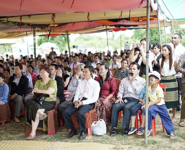 Some 300 people gathered under tents for the unveiling of the design of the local Baha'i House of Worship