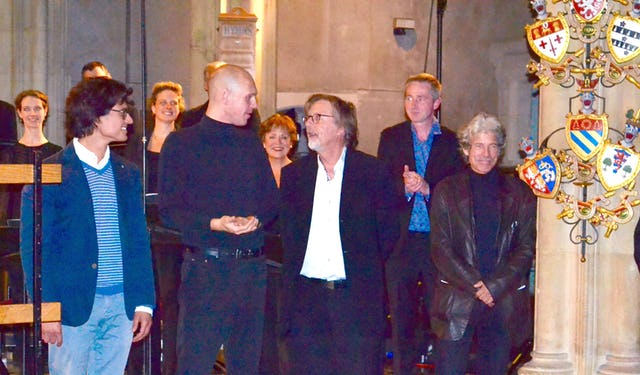 Professor Lasse Thoresen, pictured centre, talks with fellow composers from Europe, at St. Giles' Cripplegate church, London, following a performance by the BBC Singers, 30 September 2015.