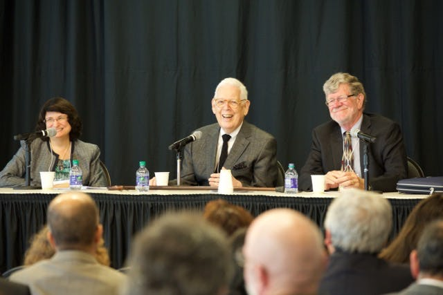 Speakers on a panel at the Symposium on the Iranian Baha'i refugee movement to Canada, held in Ottawa on 21 September 2015. From left to right: Janet Grinsted, Deputy Director, Northwest Territories Human Rights Commission and former staff of the International Baha'i Refugee Office; Douglas Martin, Secretary General, Baha'i Community of Canada, 1965-1985; and Gerry Van Kessel, Former Director-General of Operations, Refugee Branch, Citizenship and Immigration Canada. (Photo by Emad Talisman)