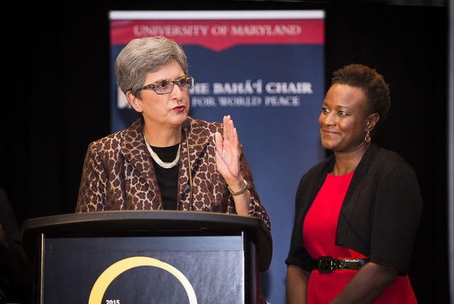 Dr. Hoda Mahmoudi (left), holder of the Baha'i Chair for World Peace, addresses the audience of the Global Transformations conference at the University of Maryland. Dr. Prudence Carter, a sociologist at Stanford University, is on the right.