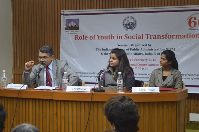 Major General Dilawar Singh (left)—Director General of the Indian government's Ministry of Youth and Sports—speaks on a panel on youth in community-building. Saudamini Pandey (center)—Project Manager of an NGO—looks on with Pooja Tiwari (right)—a youth representing the Baha'i community.