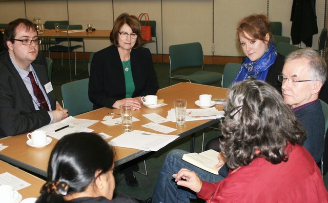Louise Ellman (centre), the Chair of the All-Party Parliamentary Group on the Baha'i Faith, joins in a small group discussion.