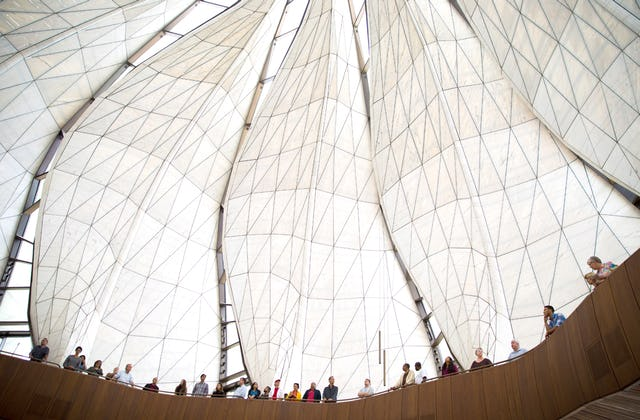 Visitors to the House of Worship in Santiago, Chile stand in the glass and marble wings of the Temple.