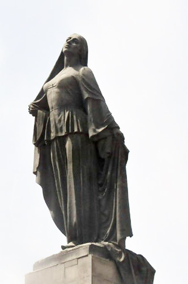 The statue of a liberated woman that stands in central Baku depicts a woman casting off her veil and is said to have been influenced by the story of Tahirih.