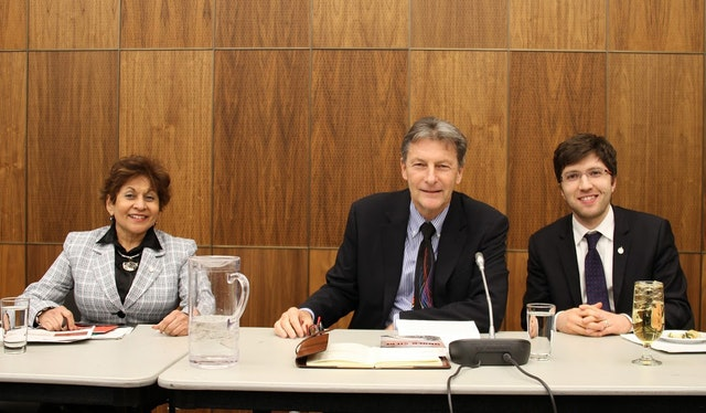 Yasmin Ratansi (left), the first female Muslim Member of Parliament, sits with MPs John McKay (middle) and Garnett Genuis (right) at the conference in Ottawa on the role of religion in Canadian society.