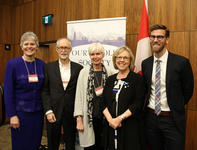 "Representatives of the Baha'i community Gerald Filson (second from left) and Geoffrey Cameron (right) stand with steering committee members at the ""Our Whole Society: Religion and Citizenship at Canada's 150th,"" including Elizabeth May (second from right), leader of the Green Party."