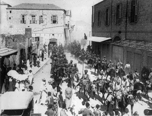 Indian lancers in Haifa, 1918 (photo courtesy of the British War Museum, accessed through Wikimedia Commons#/media/File:IndianlancersinHaifa1918.jpg)).