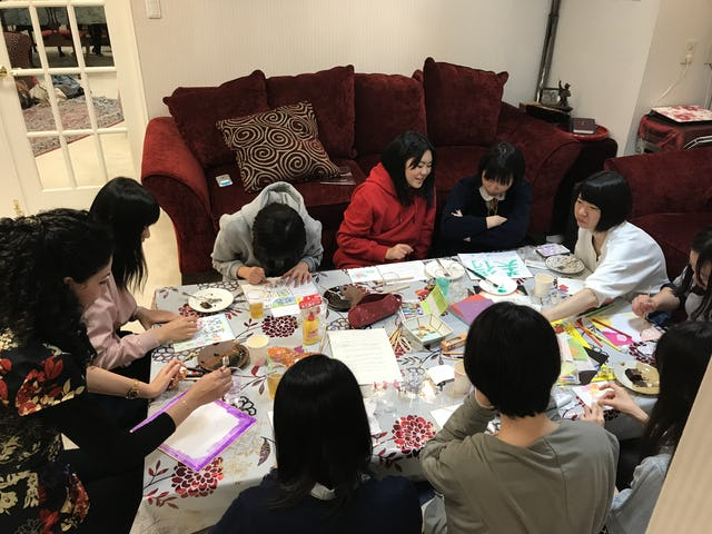 Youth in Akita, Japan, gather in a home to celebrate the bicentenary.
