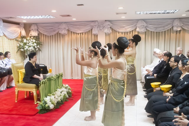 Princess Soamsawali watches a dance performance at a celebration of the 200th anniversary of Baha'u'llah's birth in Bangkok.