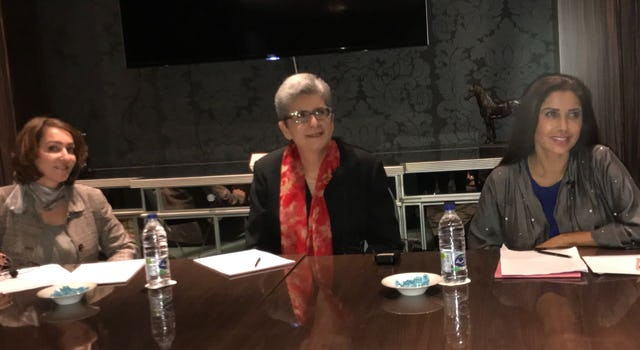 Current holder of the Baha'i Chair for World Peace, Prof. Hoda Mahmoudi (center), presented at two events in the United Arab Emirates last month.