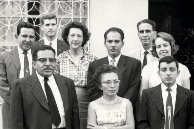 The first National Spiritual Assembly of El Salvador was elected in 1961. All nine members appear in this official photograph. In back from left are Napoleon Gonzalez, Quentin Farrand, Marcia Steward de Matamoros, Rafael Garcia, Marco Antonio Martinez, and Jeanne de Farrand. In front, Jose Maria Padilla, Marta de Herrador, and Gabriel Torres.