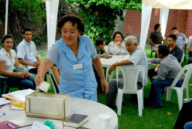 A delegate to this year's national convention in El Salvador casts her vote for the National Spiritual Assembly. It was the 50th such Baha'i convention in that country, and special events were planned to mark the occasion. (Photos courtesy of the Baha'i Community of El Salvador)