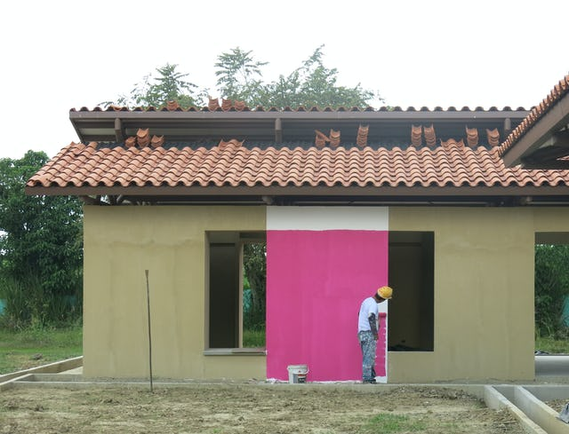 Ancillary buildings at the House of Worship in Norte del Cauca are being painted in vibrant colors.