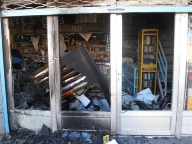 A Baha'i-owned shop in Rafsanjan, Iran, targeted by arsonists. Several businesses run by Baha'is have suffered serious damage in a wave of attacks in the city since 25 October 2010.