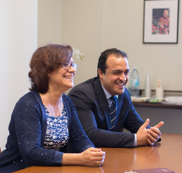 Zoraida Garcia Garro (left) and Saba Mazza, members of the Continental Board of Counsellors in Europe, laugh during their conversation with fellow Counsellors.