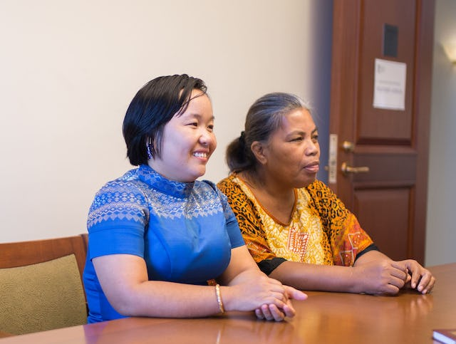 Sokumtheary Reth (left), a counsellor from Cambodia, and Ritia Bakineti, a colleague from Kiribati, listen intently to a conversation about the role of youth in their communities.