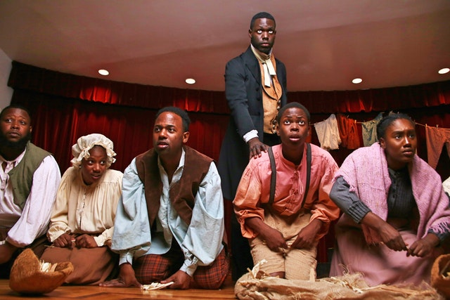 """This photo captures a scene from Henry Box Brown. The musical draws on the rich legacy of 19th-century spirituals, which arose out of the suffering and hardships endured by enslaved peoples of African descent. These pieces often convey deep spiritual values and insights.""""All these songs have come from oppression, from forgiveness of the oppressors, songs that distracted you from the brutality of the life that you were in, """"explains the show' s musical director and co - composer.""""All of these songs are connected to God…"""""""