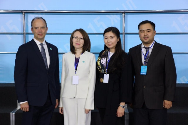 (from left) Joshua Lincoln, Secretary-General of the Baha'i International Community; representative Lyazzat Yangaliyeva from the Baha'i community of Kazakhstan; Guldara Assylbekova of the International Center of Cultures and Religions; and Serik Tokbolat, also representing the Baha'i community of Kazakhstan