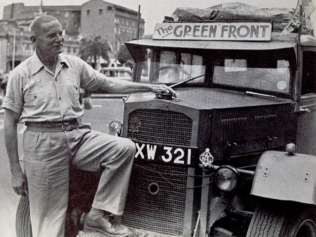 St. Barbe stands in front of his vehicle during his the Green Front Against the Desert expedition in 1952. (Credit: University of Saskatchewan Library, University Archives & Special Collections, Richard St. Barbe Baker Fonds)