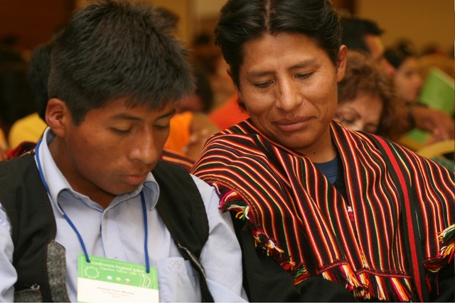 Two of the 600 participants at the Baha'i conference in Antofagasta, Chile, on 29-30 November are shown at a plenary session.