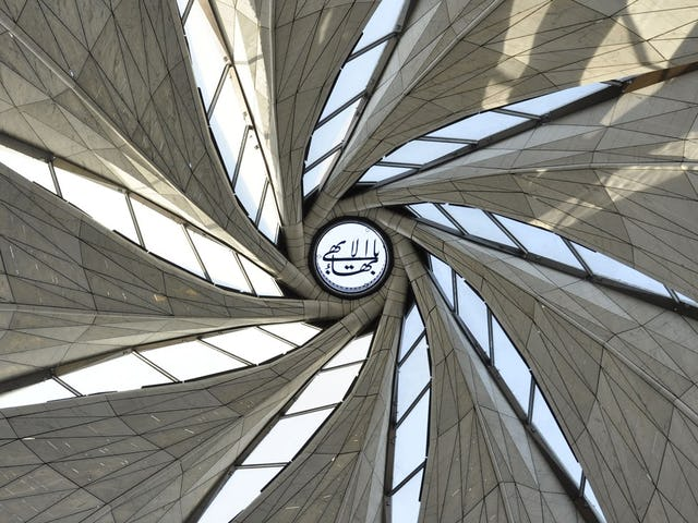 "A calligraphic rendering of the invocation ""O Glory of the All-Glorious"" was lifted into position at the apex of the Baha'i House of Worship in Chile."