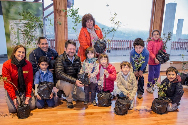 The trees donated to Santiago were raised on the land surrounding the Baha'i House of Worship. The community donated some of these plants to the city, where they will be planted in parks and other areas.