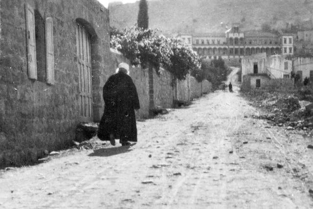 This 1920 photo shows 'Abdu'l-Baha walking from His house on Haparsim Street in Haifa. He worked tirelessly to promote peace and to tend to the safety and well-being of the people of Akka and Haifa.