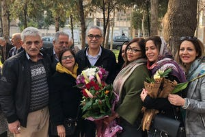 Afif Naeimi (center) stands with loved ones in Tehran earlier today after completing his unjust 10-year prison sentence.