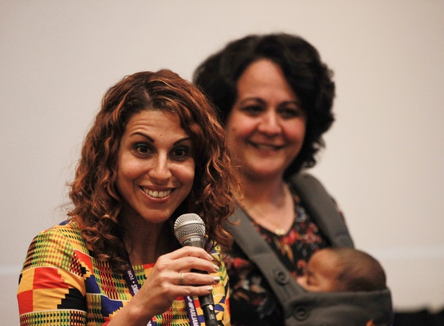 May Taherzadeh (left) speaks about her film Mercy's Blessing as Negar Abay from the Baha'i Office of Public Affairs of the United States looks on during a session at the Parliament of the World's Religions in Toronto, Canada, in November.