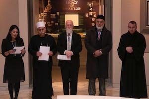 (From left) Carmel Irandoust, deputy secretary-general of the Baha'i International Community, reads a prayer as Sheikh Jaber Mansour, Rabbi David Metzger, Emir Muhammad Sharif Odeh, and Father Yousef Yakoub listen.