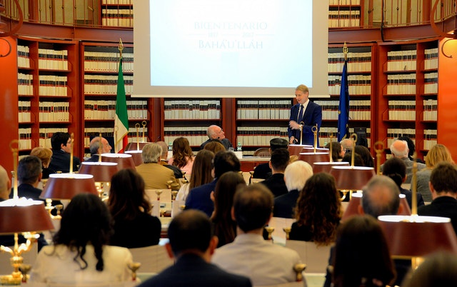 Italian Senator Lucio Malan speaks during a celebration of the bicentenary of Baha'u'llah's birth, held in the Italian Parliament in October 2017. Lawmakers, religious leaders, and civil servants met in the Parliament's Sala del Refettorio, where records and laws of the Italian legislature are kept and special events are occasionally held.