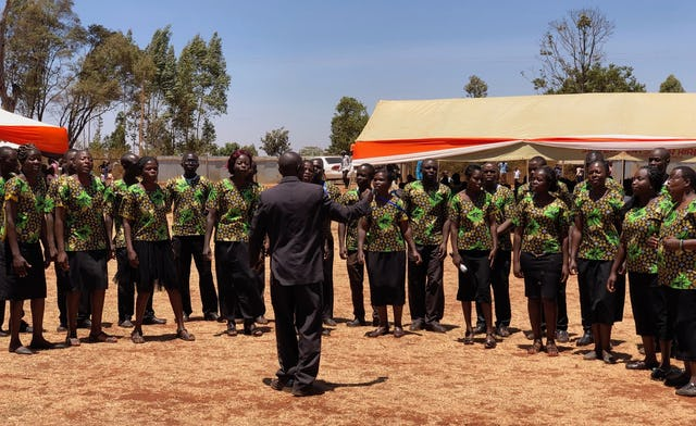 The choir of the hosting Lwanda community sings during the groundbreaking of the Matunda Soy temple.