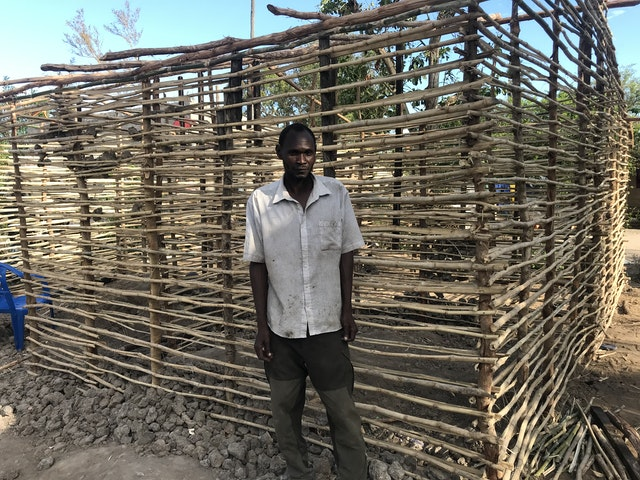 Norge Joao's home was rebuilt by a group of youth in Dondo. Mr. Joao lives with his wife and nine children, most of whom participate in educational activities organized by the Baha'i community.