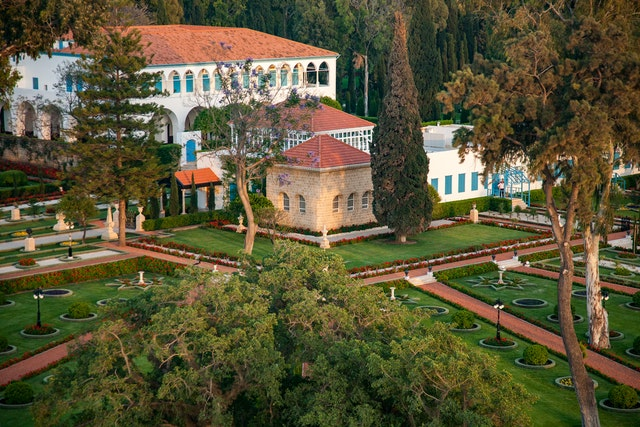As greater numbers of people from around the world visit the Holy Land for Baha'i pilgrimage, its transformative power is being felt by individuals and communities. This aerial photo shows the Shrine of Baha'u'llah in front of the Mansion of Bahji, two places that are visited as part of the current Baha'i pilgrimage program.