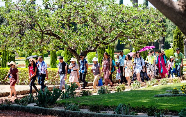 Pilgrims walk through the gardens in Bahji.