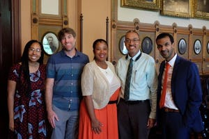 From left to right: May Lample, U.S. Baha'i Office of Public Affairs; Adam Rothman, the principal curator of the Georgetown University Slavery Archive; Maya Davis and Chris Haley, who curate and manage the Maryland State Archives Legacy of Slavery in Maryland Program; P.J. Andrews, U.S. Baha'i Office of Public Affairs.