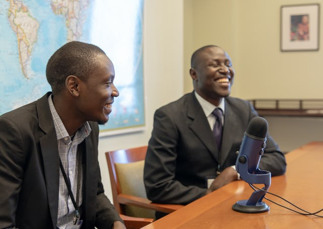 Charles Oloro (left) and Michael Okiria from Uganda speak about how growing numbers of people are attending regular gatherings for collective worship.