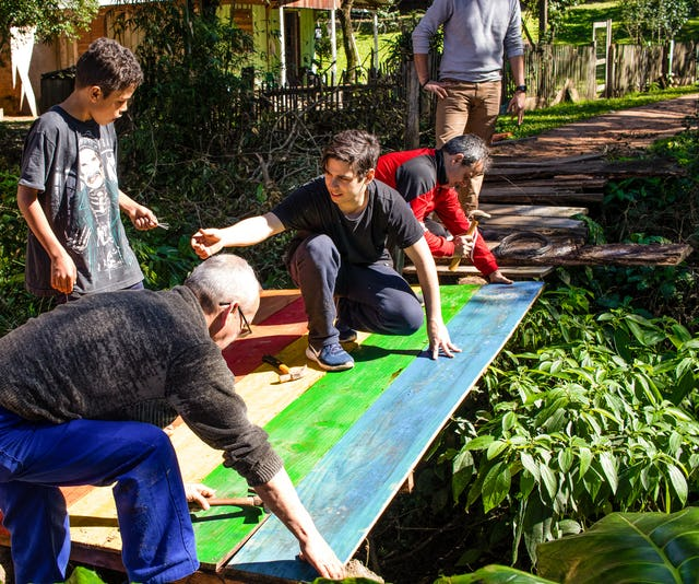 As one of several initiatives in Sapucaia, Brazil, youth and adults repair a frequently-used bridge.