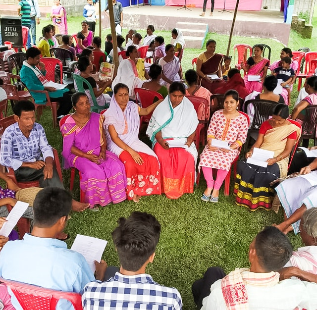 Families in Assam, India, gather to consult about how they can enhance the spirit of collective worship and service in their community.
