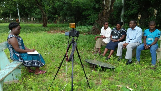 In Kenya, a film team is interviewing a family about the history of the Baha'i Faith in their country.