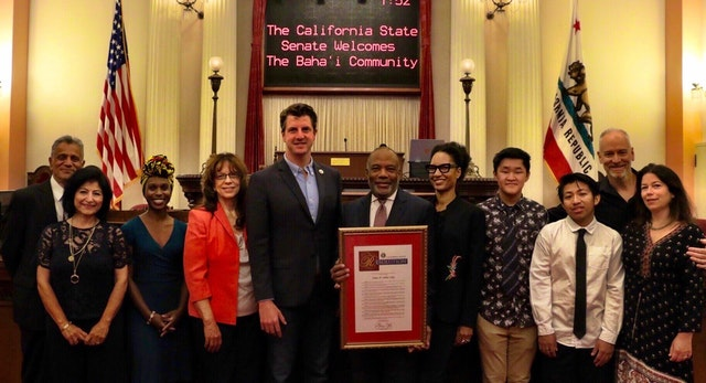 Members of Baha'i communities in California pose for a picture with state Senator Henry Stern (fifth from the left).