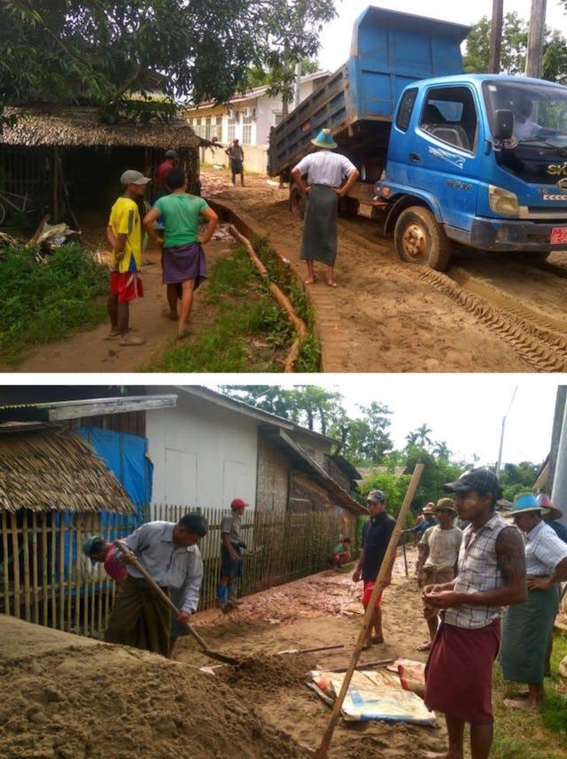 Community members in Daidanaw, Myanmar, repair a road in the village.