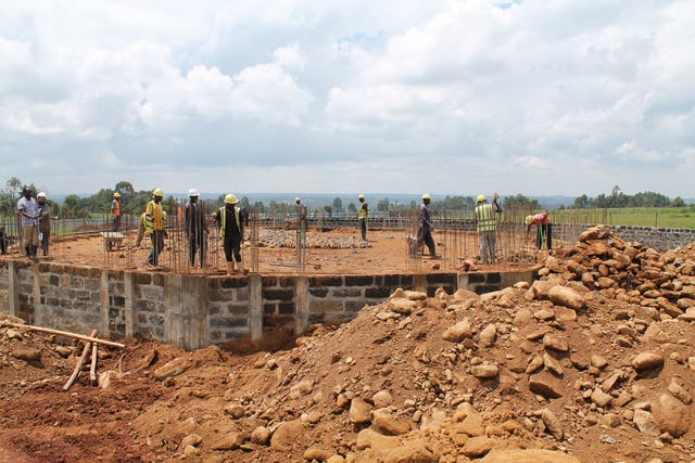 The Kenya Temple's construction crew carefully laid stones, on which concrete was later poured to form the building's foundation.